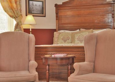 Bed front chairs in Pinkham